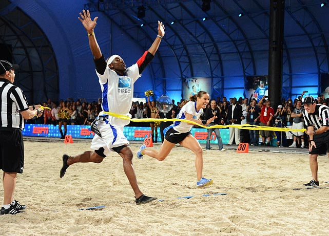 Owens beats Lolo Jones to the finish line during DIRECTV'S Seventh Annual Celebrity Beach Bowl on Feb. 2, 2013 in New Orleans.