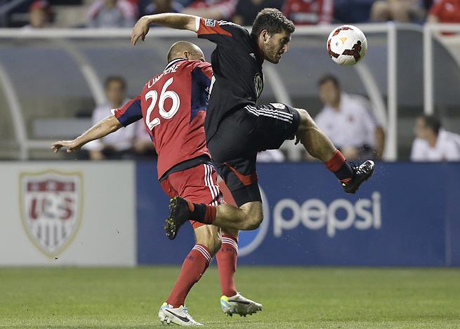 D.C. United defender Chris Korb, right, controls the ball against Fire midfielder Joel Lindpere.
