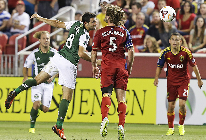 The Timbers' Diego Valeri heads the ball past a defending Kyle Beckerman during the second half.