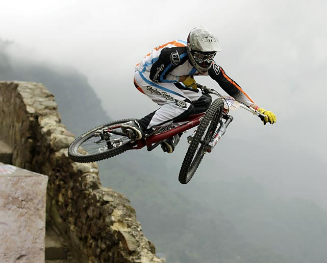 A rider launches off a jump during the Red Bull Devotos de Monserrate urban downhill mountain bike race in Bogota.