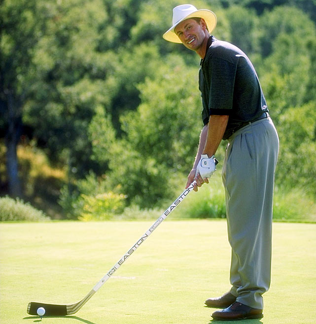 Gretzky lines up a shot during a golfing event, using a club he's more familiar with.