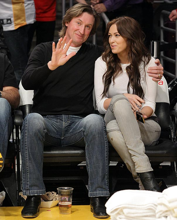 Gretzky and his daughter Paulina attend a Lakers game against the Jazz at Staples Center in 2011.