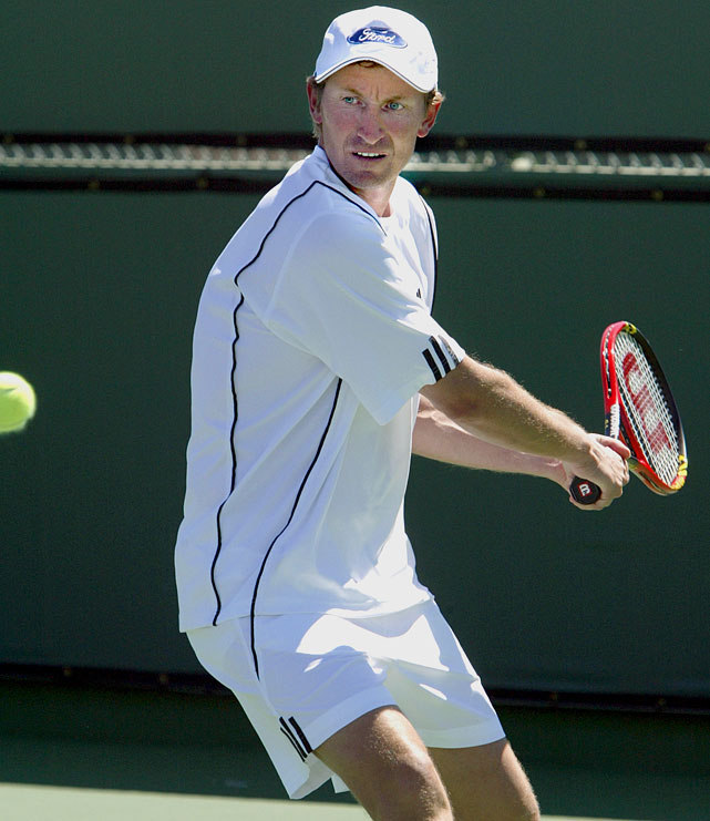 Gretzky readies a backhand swing at Indian Wells during the Pro Am Tournament to Benefit the Prostate Cancer Foundation in 2004.