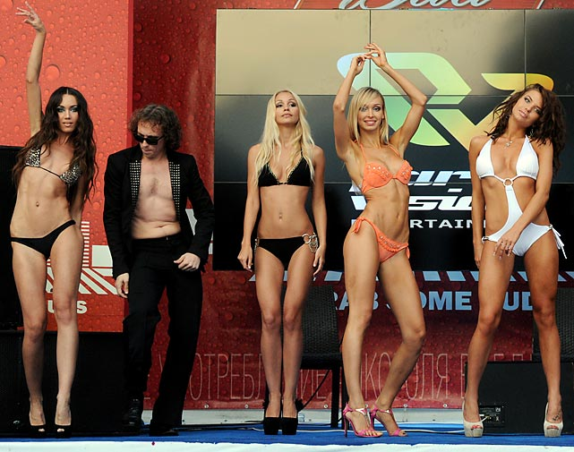 Under the watchful eye of a taciturn quality control expert, the bikini parade rolls on in Moscow.
