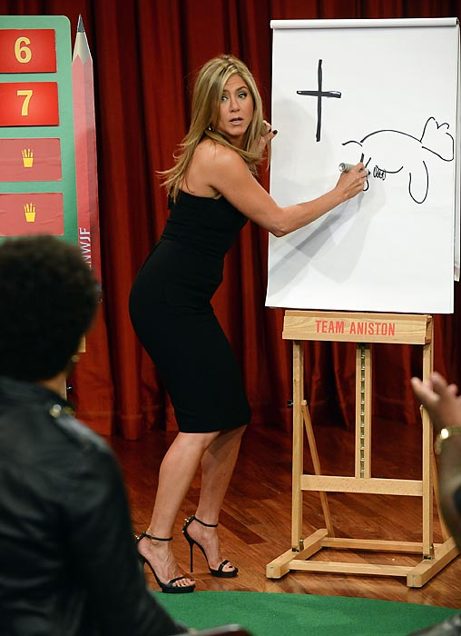 "Details are sketchy, but the star of the new major motion picture <italics>We're The Millers</italics> left partner Lenny Kravitz udderly flummoxed by her drawing of a holy cow during a spirited game of Pictionary on ""Late Night With Jimmy Fallon."" The host and his partner, CeeLo Green, milked the opportunity tfor all it was worth and won the contest."