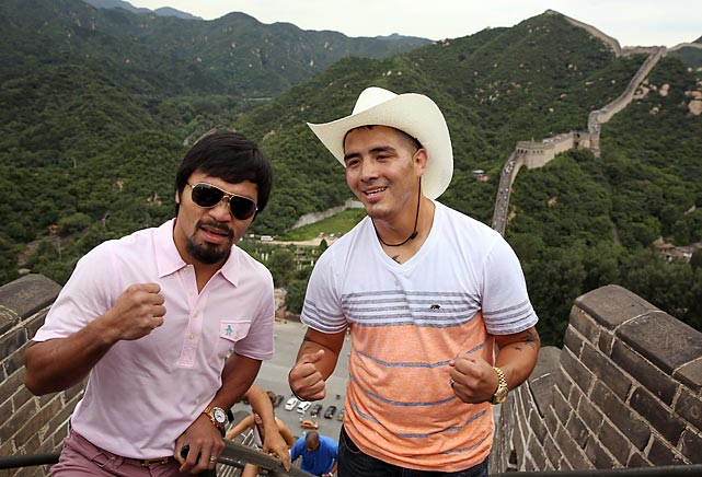 Greetings from the Great Wall. The two pugs are touring the world -- trekking a total of 23,722 miles -- to beat the media drums before they beat on each other in their bout on November 23 in Macau.