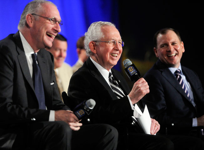 ESPN's John Skipper (left) and SEC commissioner Mike Slive (center) unveiled network plans in May.