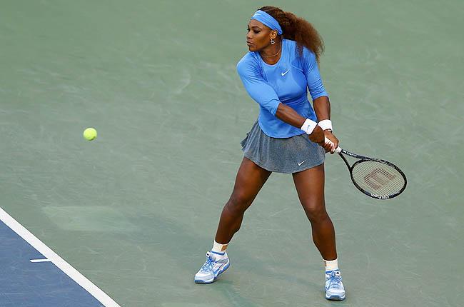 Top-seeded Serena Williams overpowered Slovakia's Magdalena Rybarikova 6-1, 6-1 to reach the semis.
