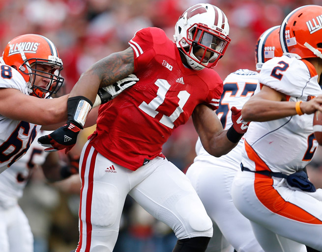Former Wisconsin DL David Gilbert will join Miami with two other transfers, coach Al Golden announced.
