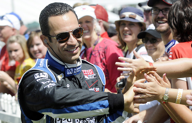 Helio Castroneves suffered minor injuries to his legs and neck after a stock car crash in Brazil.
