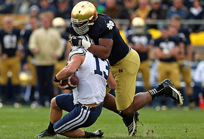 Stephon Tuitt (7) and Notre Dame surrendered just 12.8 points per game last season, second nationally.
