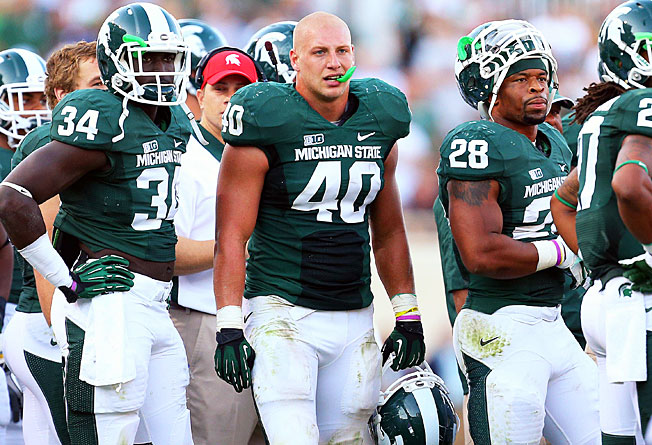 Linebacker Max Bullough (40) and Michigan State's defense allowed just 274.4 yards per game in 2012.