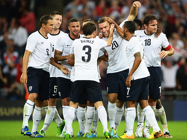 Rickie Lambert (20) celebrates his first international goal during England's 3-2 win over Scotland.
