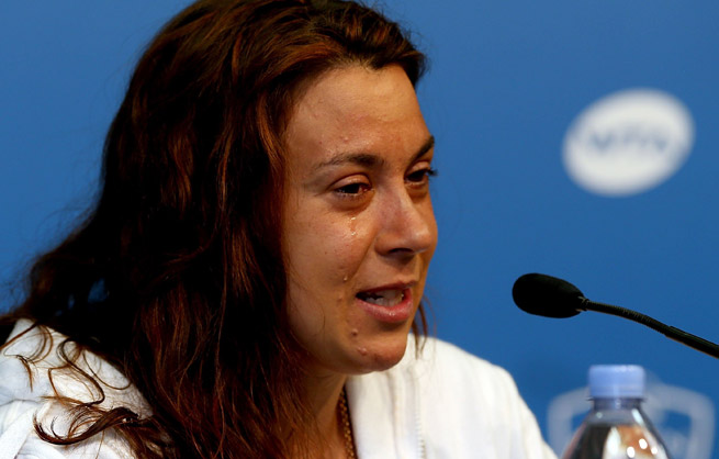 In tears, Marion Bartoli announced her retirement after losing at the Western & Southern Open.