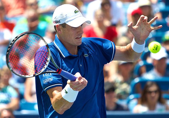 John Isner beat Novak Djokovic 7-6 (5), 3-6, 7-5, crushing his hopes of making ATP history.