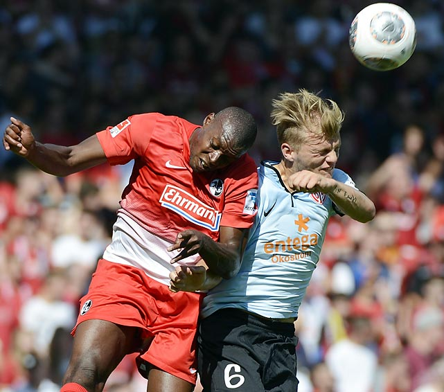 Karim Guede (L) of Freiburg battles for the ball with Johannes Geis (R) of Mainz during the Bundesliga match between SC Freiburg and FSV Mainz 05 at Mage Solar Stadium on August 17.