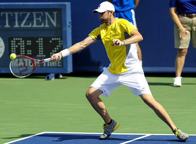 Mardy Fish, who earned a wild-card entry, defeated No. 11-seeded Evgeny Donskoy 6-3, 3-6, 6-1.
