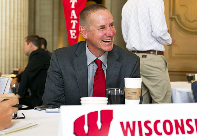 Wisconsin's Gary Andersen laughs with reporters before Big Ten media days in Chicago this summer.