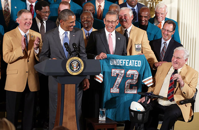 The 1972 Miami Dolphins have finally received their White House moment, 40 years after their historic undefeated season. It was a long wait for a Super Bowl championship team whose feat of 17 games without a loss has been unmatched in the NFL. President Barack Obama welcomed former team members and their then-coach, Hall of Famer Don Shula, at a White House ceremony Tuesday, Aug. 20, in recognition of their perfect season. Among those present was the team's star fullback, Hall of Famer Larry Csonka, who made the trip from Alaska. The '72 Dolphins beat the Washington Redskins in the January 1973 Super Bowl. But in 1973 President Richard Nixon was preoccupied with the Watergate scandal, and White House salutes to sports teams were less of a tradition than now. From Joe DiMaggio visiting President Eisenhower in 1953 to the UConn women pulling out the bunny ears on President Obama in 2013, here is a historical look at athletes visiting the White House.