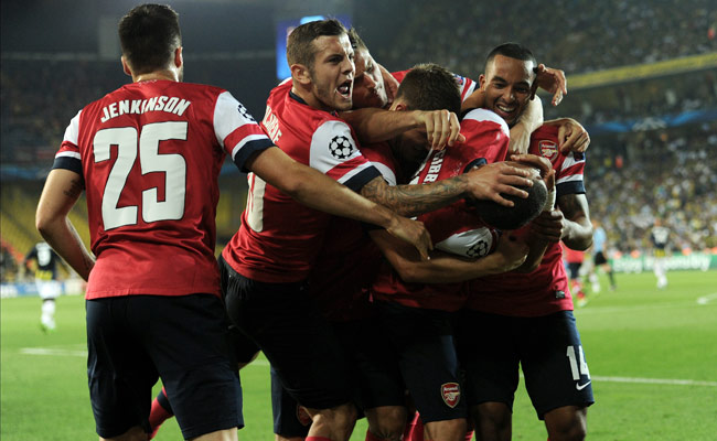 Arsenal celebrates after Aaron Ramsey's goal gave the Gunners a 2-0 lead over Fenerbahce.