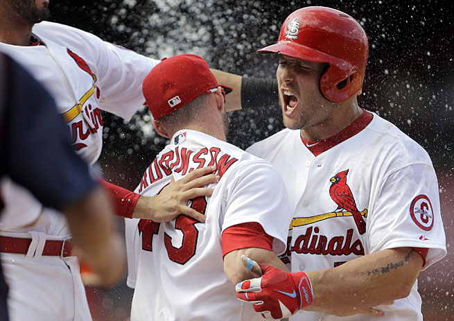 Matt Holliday (right) has heated up just in time for St. Louis, which is eyeing its ninth postseason berth in the past 14 years.