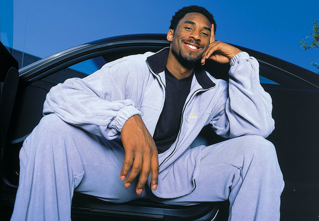 Kobe sits in what is likely one of many nice cars he owns.