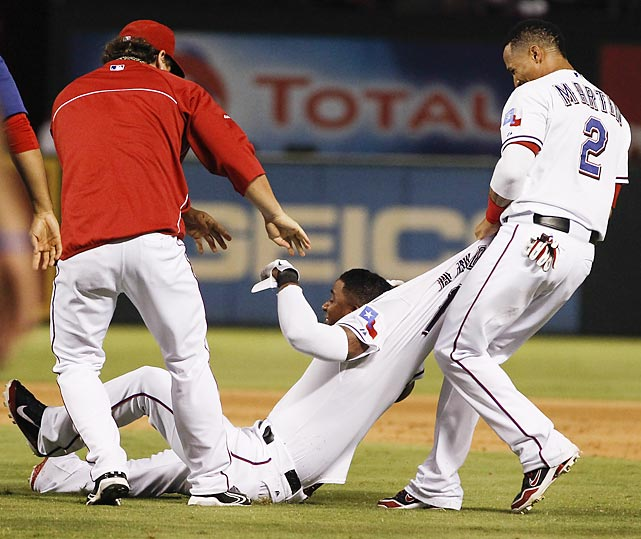 Life's a drag for Elvis Andrus of the Rangers, thanks to teammates Derek Holland (left) and Leonys Martin who got a little overexcited after Andrus hit a game-winning sacrifice fly against the Houston Astros (baseball's most valuable franchise, no less) in Arlington, Texas.