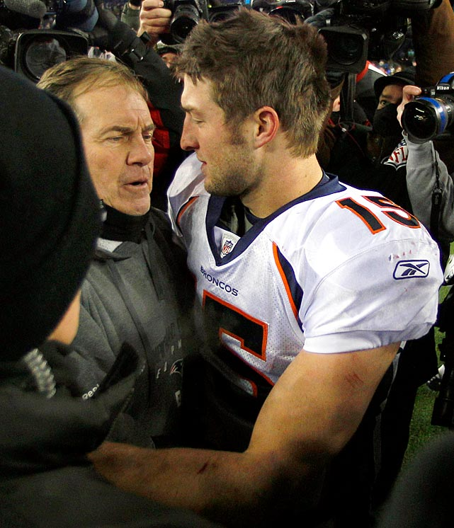 Tebow hugs Pats head coach Bill Belichick following the Broncos divisional playoff loss.
