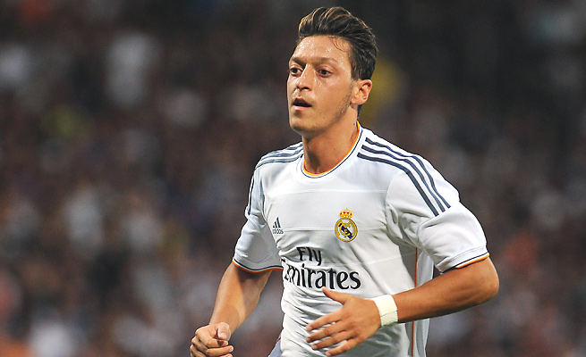 Midfielder Mesut Ozil's 50 million euro transfer fee is easily a club record for Arsenal.