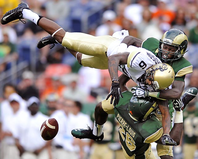 Colorado State safety Kevin Pierre-Louis (26) and cornerback Bernard Blake break up a pass intended for Colorado wide receiver Paul Richardson (6) during the second quarter of the Buffaloes' 41-27 victory on Sept. 1. Apart from this play, Richardson torched the Rams' secondary, catching 10 passes for 208 yards and two touchdowns in the debut for new Colorado coach Mike MacIntyre.