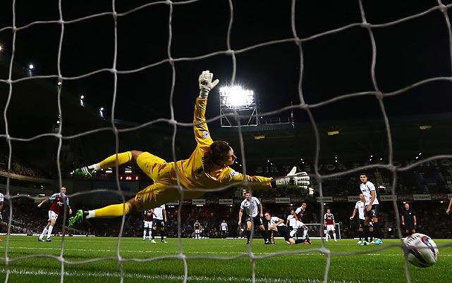West Ham United midfielder Ravel Morrison buries a shot past Cheltenham Town goalkeeper Scott Brown for the winning goal during the Hammers' 2-1 victory in the second round of the Capital One Cup on Aug. 27. Morrison also set up West Ham's other goal by drawing a free kick 25 yards out that teammate Ricardo Vaz Te curled into the top-left corner.
