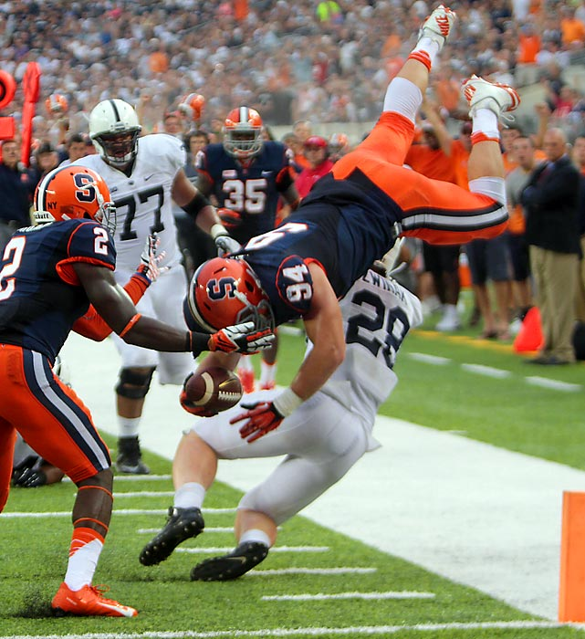 Penn State running back Zach Zwinak (28) upends Syracuse defensive end Robert Welsh, halting his 31-yard interception return at the one-yard line during the fourth quarter last Saturday. Welsh's pick set up a goal line score for Orange running back Jerome Smith, but the Nittany Lions hung on to win 23-17.