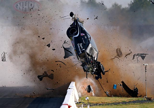Tim Tindle's 1969 Camaro crashes and disintegrates during the first round of Pro Mod drag racing competition at the NHRA U.S. Nationals at Lucas Oil Raceway in Indianapolis on Sunday. Incredibly, Tindle walked away from the accident with no major injuries.