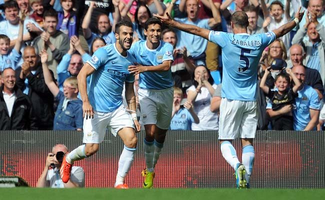 Having joined Manchester City more than a month ago, Alvaro Negredo (left) scored on Saturday.