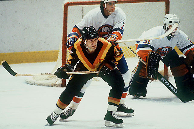 The Canucks suffered 16 straight losing seasons and yet managed to make it to the Stanley Cup Finals in 82, only to be swept by the New York Islanders. Not so difficult a feat for the Canucks when you consider that 16 out of 21 NHL teams made the playoffs. Pictured is Stan Smyl (1978-91 Canucks).