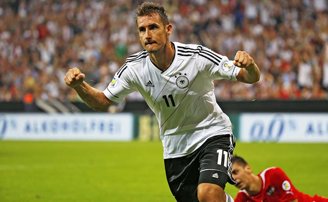 Miroslav Klose celebrates after scoring his record-tying 68th goal for Germany.