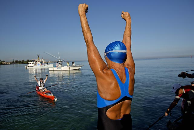 "In her fifth crack at it, and at the ripe old age of 64, the intrepid Nyad became the first swimmer to make it the full 110 miles from Havana, Cuba to the Florida Keys without a protective shark cage. However a pack of skeptical marathon swimmers ripped her feat on social media, poo-poohing it as ""dishonest"" because she had a support boat and protective wetsuit."