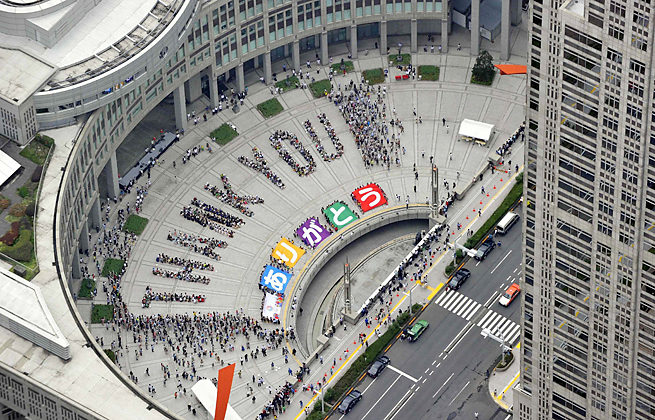Tokyo residents spell out the words 'Thank You' in celebration of winning the 2020 Olympics.