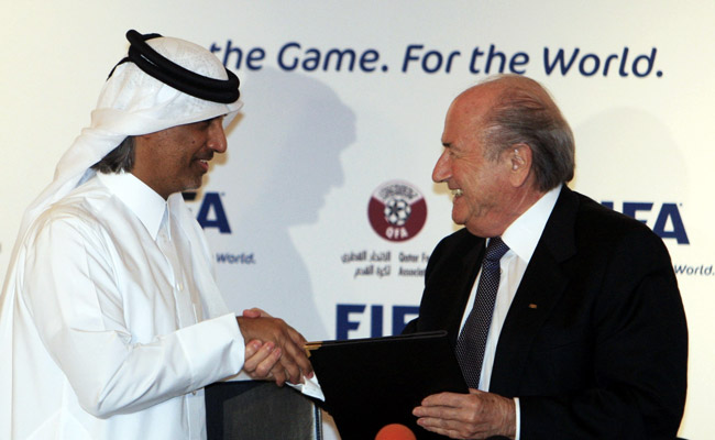 Sepp Blatter (right) shakes hands with the president of the Qatar Football Association.