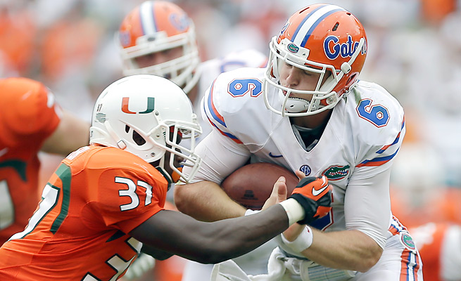Jeff Driskel committed three turnovers, including two red zone picks, against Miami on Saturday.