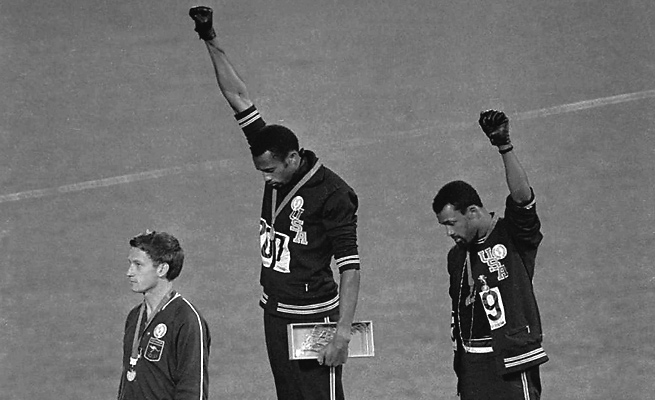 Though not a supporter of gay rights, Tommie Smith (center) said athletes must decide for themselves whether to protest Russia's anti-gay law at the 2014 Sochi Olympics.