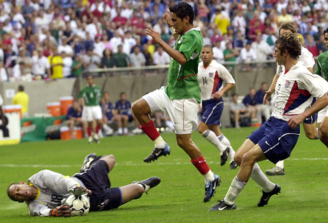 Tim Howard (left) in his first U.S.-Mexico appearance in 2003 in Houston.