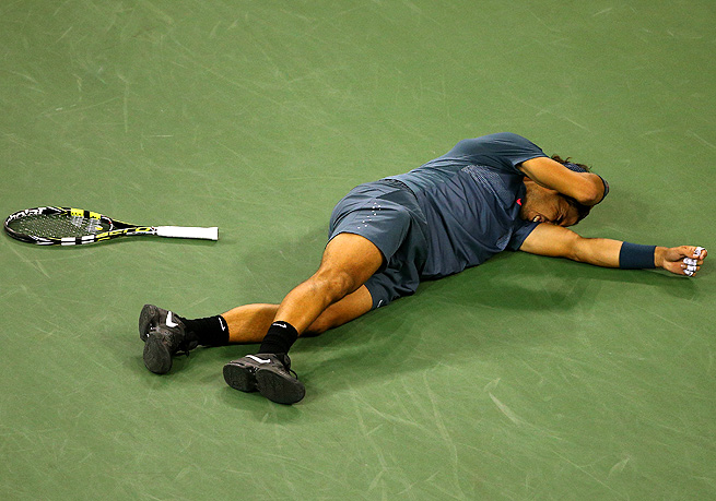Rafael Nadal collapsed to the court after beating Novak Djokovic to win his second U.S. Open title.