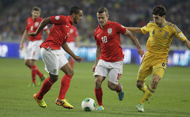 England's Theo Walcott (7) and Jack Wilshere (10) failed to show the chemistry they have at Arsenal.
