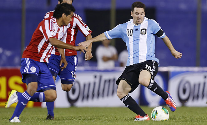 Lionel Messi scored two penalty kicks to help Argentina qualify for the 2014 World Cup in Brazil.
