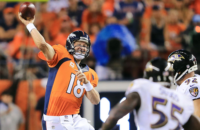 Peyton Manning tied an NFL record Thursday, throwing for seven touchdown passes against the Ravens.