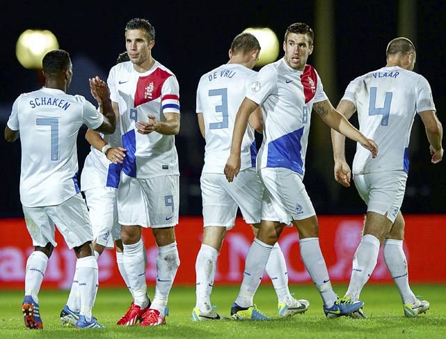 With two goals against Andorra, Robin van Persie (second from left) helped give the Netherlands its seventh win in eight group games, automatically qualifying the 2010 runner-ups for Brazil.