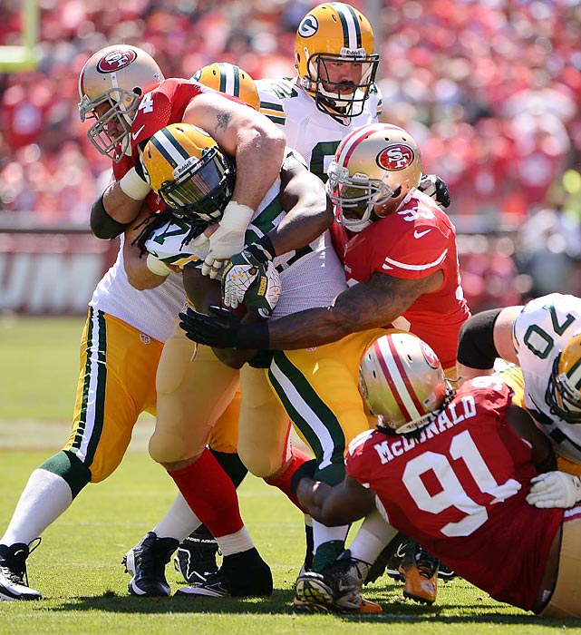 Packers running back Eddie Lacy (27) is hit high and low by 49ers defensive tackles Ray McDonald (91) and Justin Smith (94), and linebacker NaVorro Bowman (53), during San Francisco's 34-28 victory over Green Bay on Sept. 8. The Packers had upgraded their anemic rushing attack by drafting Lacy in the second round last spring, but they rushed for just 63 yards on 19 carries against the 49ers' rugged defense.