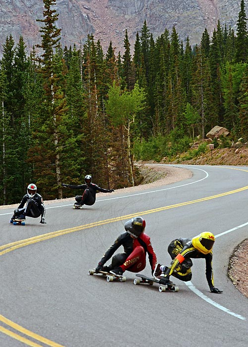 Louis Pilloni (far right, yellow helmet) cuts hard into a corner pursued closely by Zak Maytum (black helmet) as the two race down Pikes Peak outside of Colorado Springs, Colo., during the International Pikes Peak Downhill Longboarding competition on September 8. Riders reached speeds of up to 55 mph on the 1.4-mile course, which dropped 680 feet from a starting elevation of 11,446 feet. Maytum, a native of Boulder, won the race.