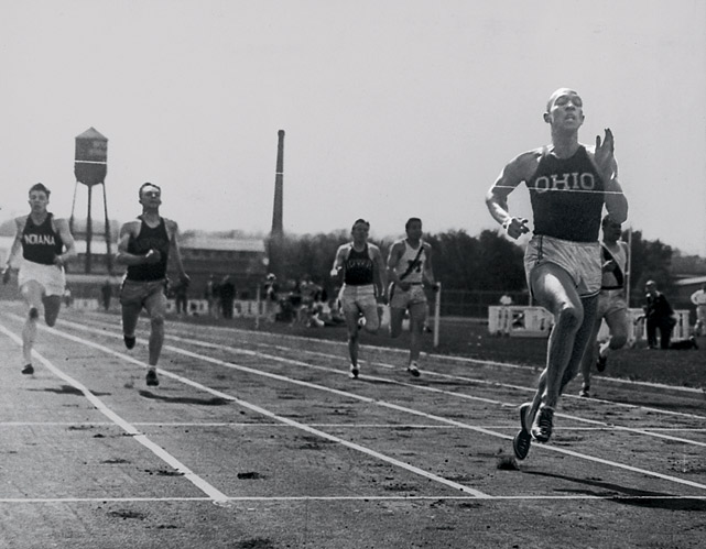 Jesse Owens of Ohio State crosses the finish line in the 220-yard dash with a record speed of 20.3 seconds at the Big Ten Western Conference Track and Field meet at the University of Michigan on May 25, 1935.